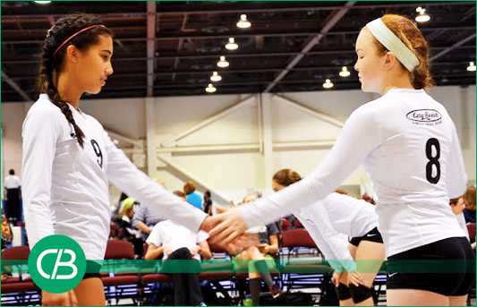 Girl Volleyball Players Shaking Hands at City Beach Volleyball